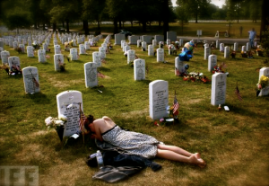 woman laying in cemetery